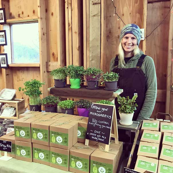 Laura at holiday sale with microgreens and growing kits